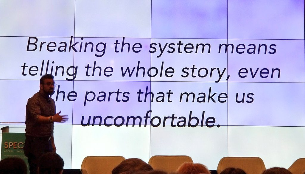 """Rohit Malhotra, Center for Civic Innovation Atlanta in front of quote that says """"Breaking the system means telling the whole story, even the parts that make us uncomfortable."""""""