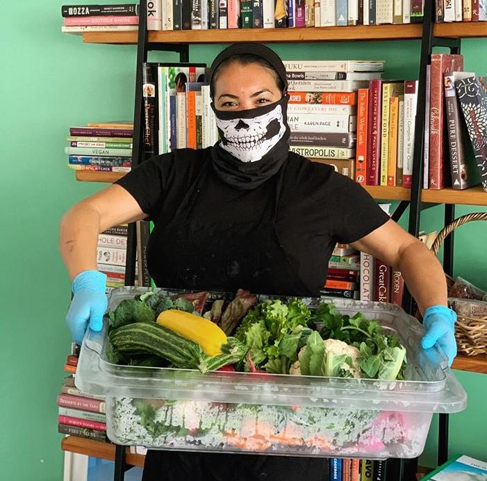 Miranda Gregory of LuckyBolt picks up produce during COVID-19