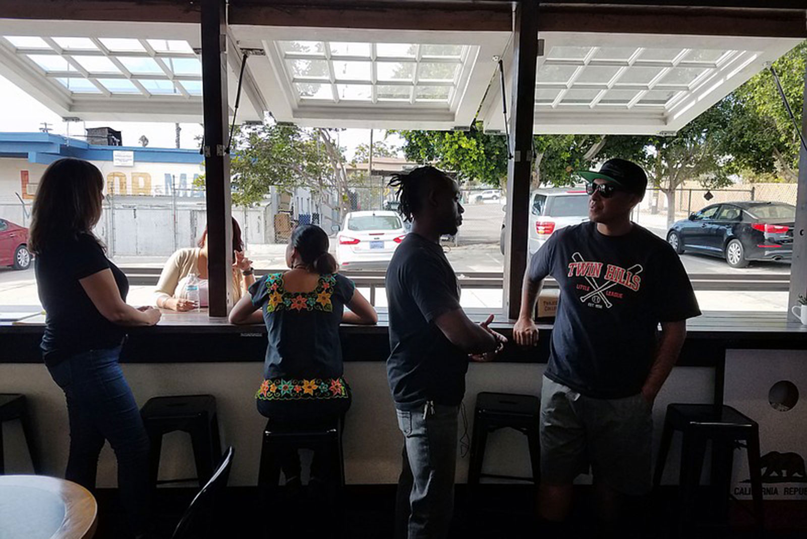 Tommy Walker and other owners of Project Reo Collective gather at their coffee shop, Sept. 30, 2018