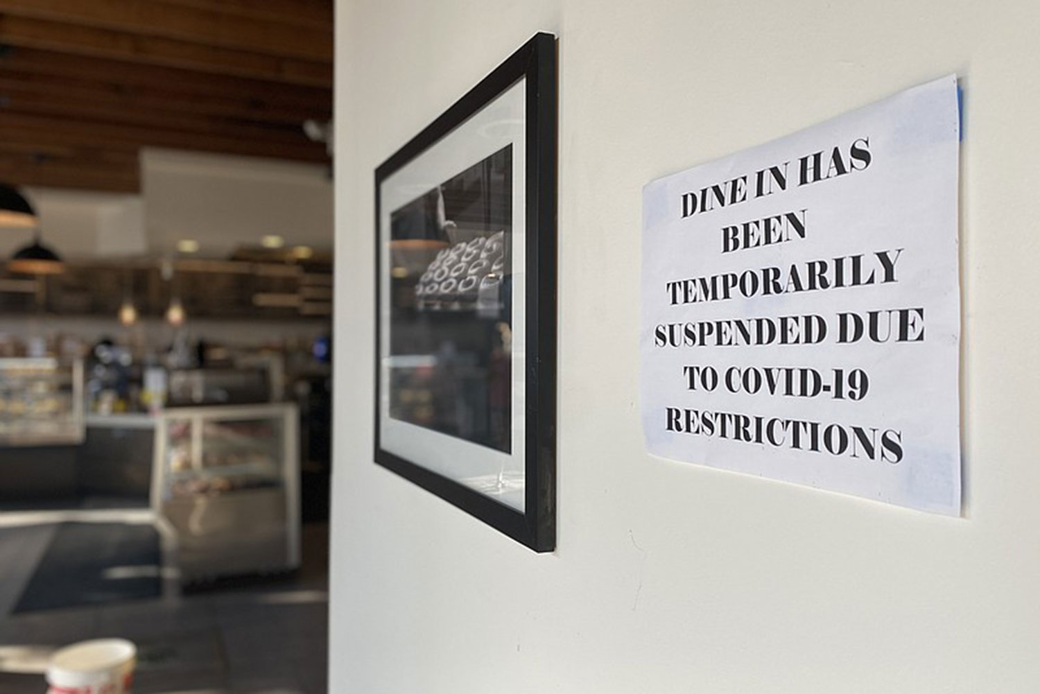 A sign notifying customers dine-in has been temporarily suspended because of the coronavirus pandemic at Solomon Bagels & Donuts in North Park. Oct. 1, 2020