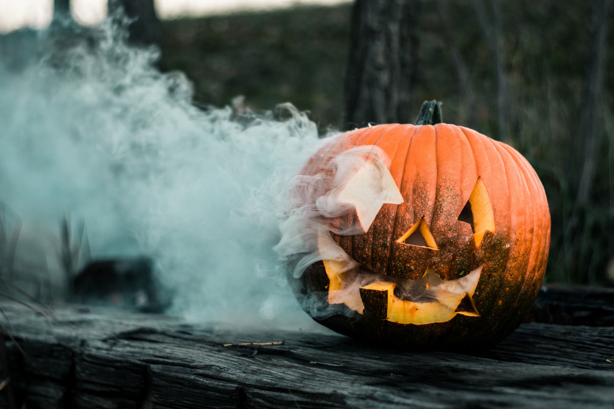 a jack-o-lantern with smoke coming out