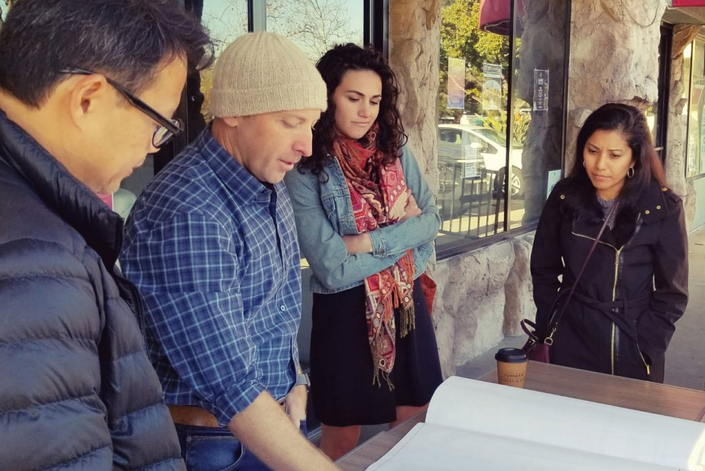 The LuckyBolt team reviews blue prints