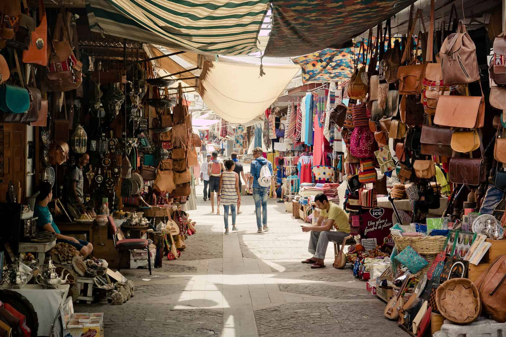 people walking through a middle eastern market